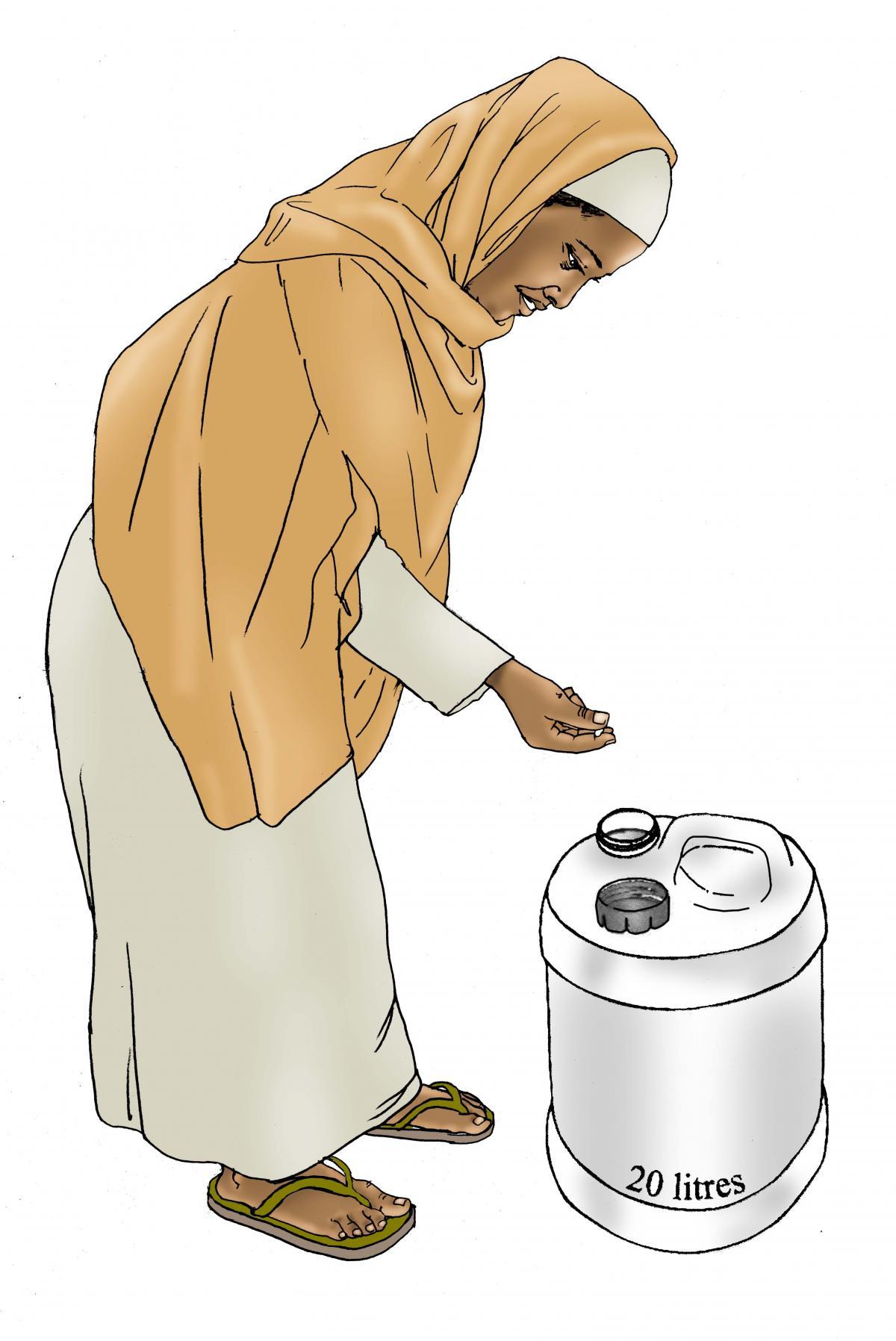 Sanitation - Woman chlorinating water - 05 - Kenya Dadaab