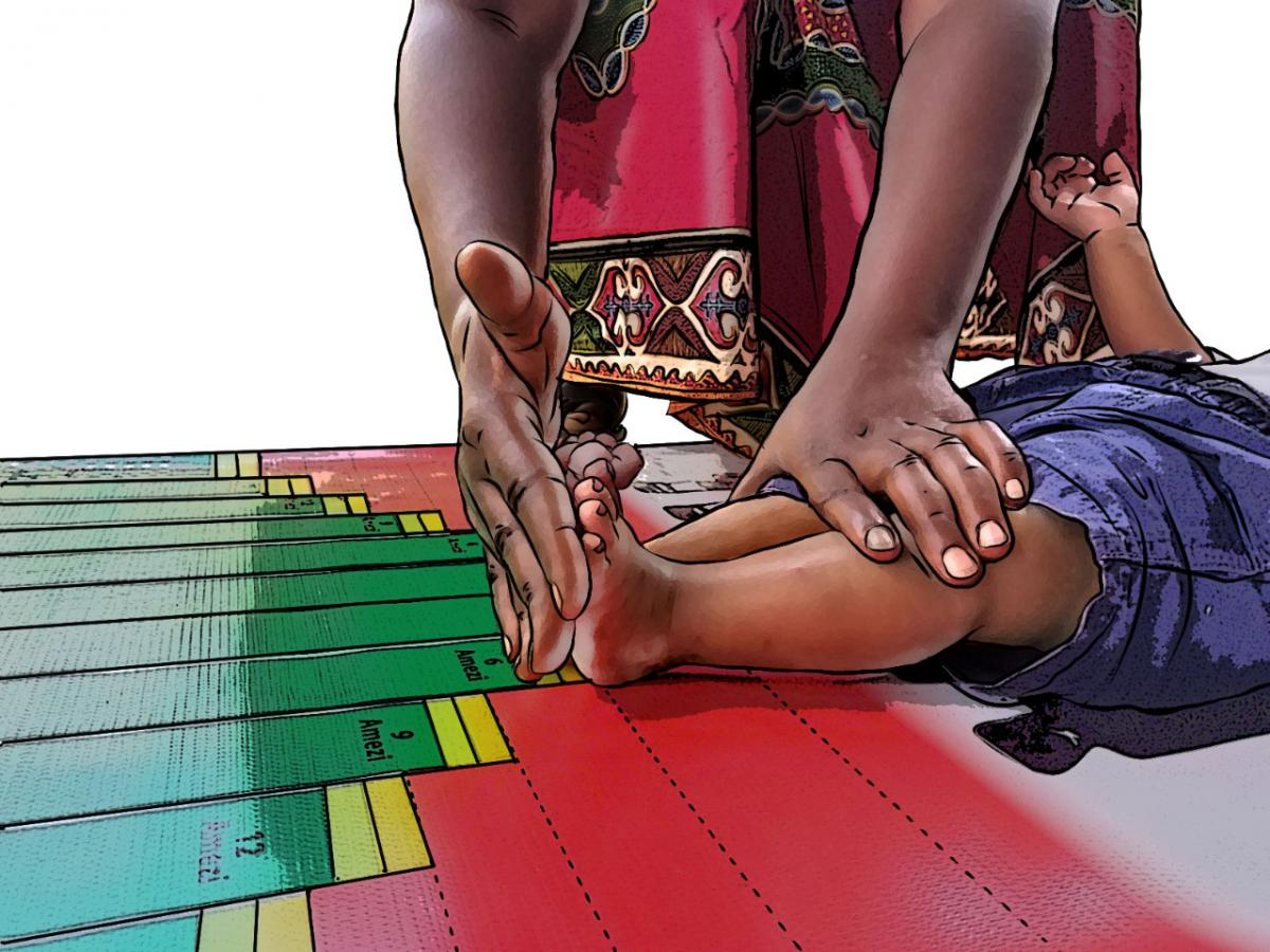 Child Health Care - Close up of community health worker measuring length at baby's feet - 03 - Rwanda
