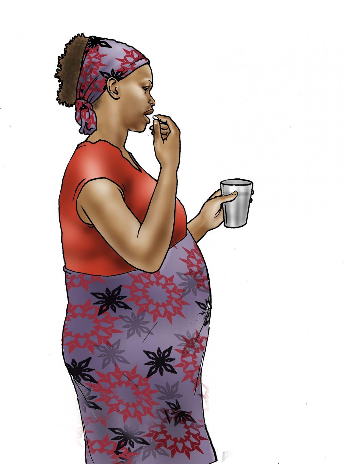 Maternal nutrition - Pregnant woman taking medicine - 04 - Nigeria