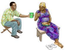 Maternal Nutrition - Pregnant woman eating vitamin a meal - 03 - Sierra Leone