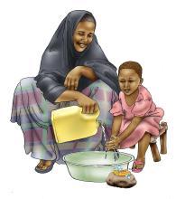 Sanitation - Mother teaches child to wash hands - 01 - Kenya Dadaab