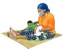 Hygiene - Mother washing baby's bottom - 03 - COVID