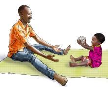 Learning through Play - Father playing ball with girl child - 02B - Rwanda