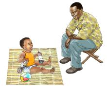 Father support - Father watching over baby - 02 - Sierra Leone
