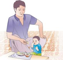 Complementary feeding - Father feeding child 9-12 mo - 01 - Kyrgyz Republic