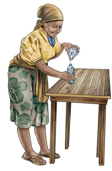 Hygiene - Mixing soap water for tippy tap - 05 - Sierra Leone