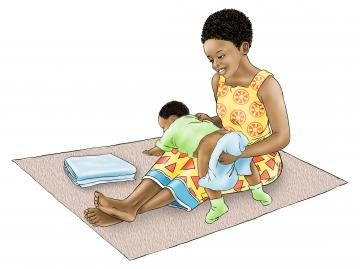 Family - Sibling washing baby's bottom - 03 - Nigeria