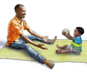 Learning through Play - Father playing ball with boy child - 02C - Rwanda