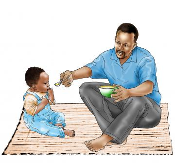 Complementary feeding - Father feeding child 9-12 mo - 01 - Nigeria